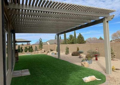 lattice patio cover over artificial grass with kitty cat