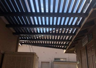 lattice patio cover spanning two buildings