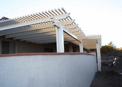 white lattice patio cover with wall