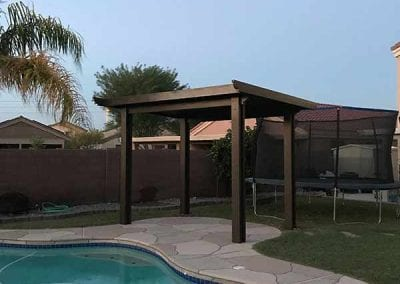 Solid patio cover by pool
