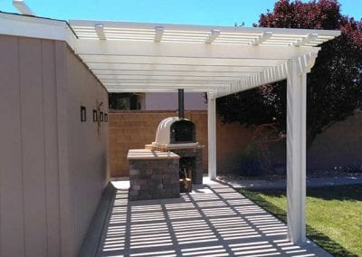 Third picture of lattice patio cover with wood burning oven